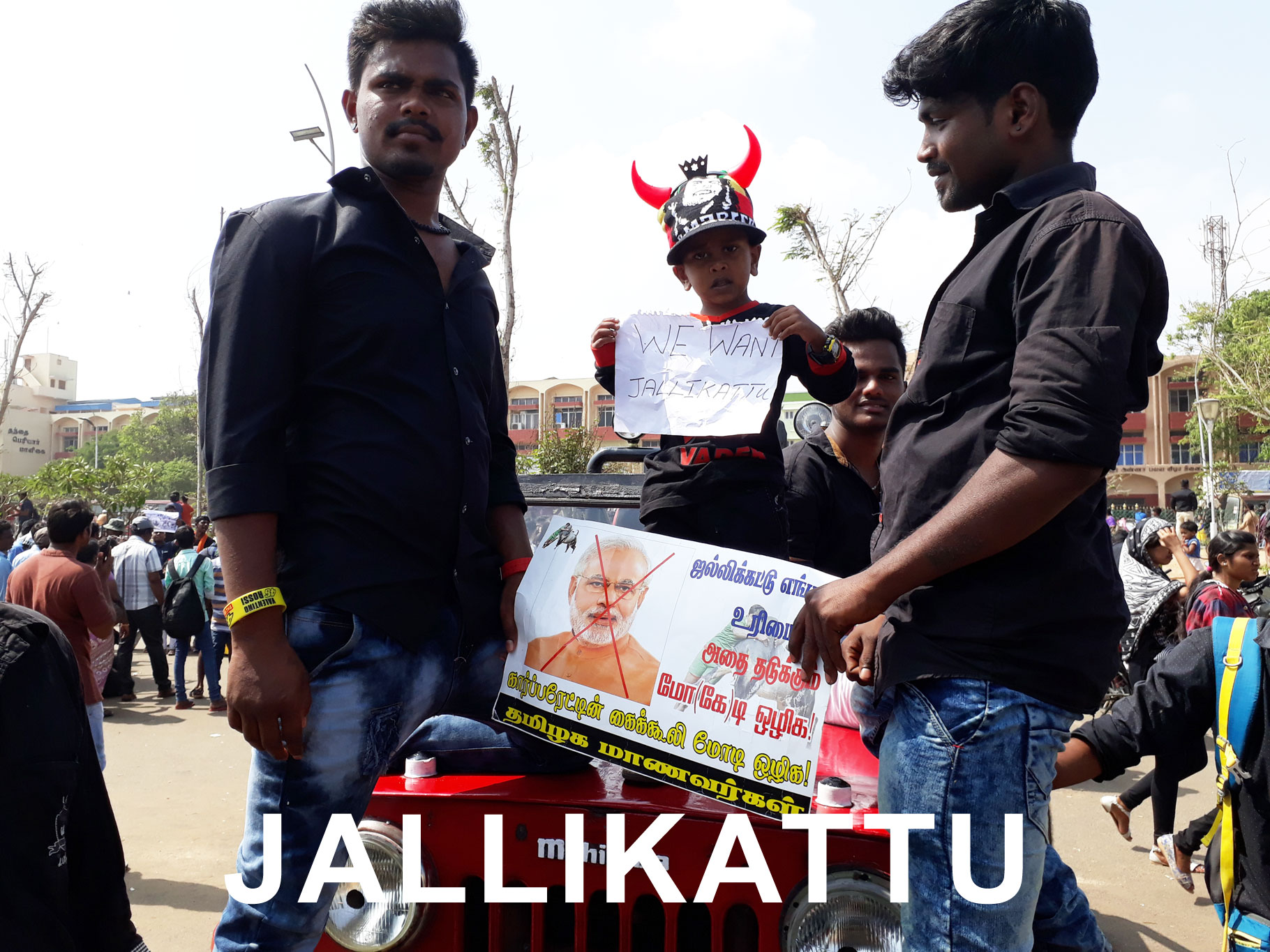 people holding anti modi poster