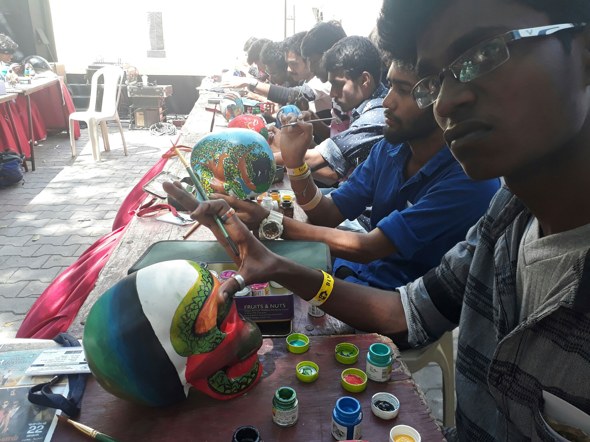 students are participating scull painting contest at miraki